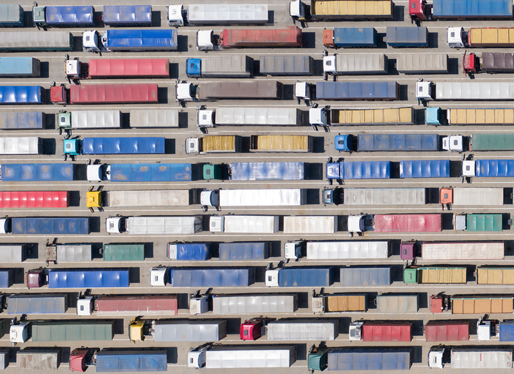 Arial view of long lines of trucks.